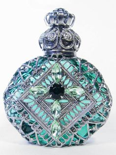 Mouth-blown glass perfume bottle handmade in the Czech Republic by a 200-year-old family-run business. With handmade wiring & hand-placed stones. Love to mimic this on the Patron bottles I've saved.