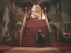 Red carpeted staircase in house Rhett and Scarlet built in Gone With The Wind.