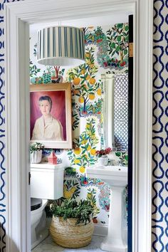 Bathroom with citrus wallpaper and plenty of plants  #bathroom #maximalism #inte...