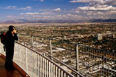 Tourist on viewing deck of Stratosphere Tower.