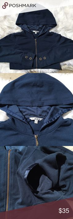 CAbi zip up hoodie jacket Item: CAbi zip up hoodie jacket Color: navy blue Size: SMALL Condition: Preloved in good condition. Cute embellishments on wrist area. Inside of the hood is a different material. Zipper works great. Buttons in working condition. No rips or holes. Questions? Offers? CAbi Jackets & Coats