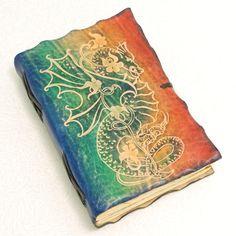 GILD Bookbinders  |  DRAGON, Leather Journal via Etsy.