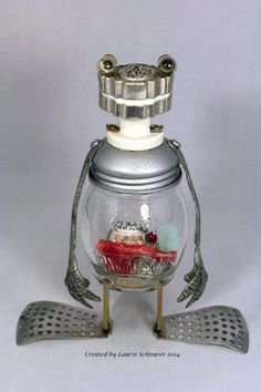 """""""Larry the Lizard"""" ~ Original junk art sculpture created by Laurie Schnurer in 2014. His head is a pill container and can be opened. You can also screw the top off the jar to replace his """"guts"""" with whatever you'd like."""