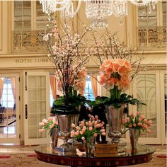 Ethereal pink blooms adorn The Plaza lobby this week. Stunning Amaryllises, Dutch Tulips and delicate Quince flowers transformed the hotel lobby into a serene ambiance. The Plaza certainly looks pretty in pink! Art Floral, Floral Design, Flower Vases, Flower Art, Hotel Flower Arrangements, Nothing But Flowers, Jeff Leatham, Hotel Flowers, Corporate Flowers