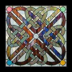 """Two individual celtic knot stained glass patterns, each a different colour, weave together to create this panel. I tried to match glass in the dark knot so the colour would appear to flow throughout. This is a fairly large window and needs a sturdy frame. Pattern is suitable for copper foil only. � 24"""" X 24"""" � 209 pieces � level of difficulty advanced � materials list and colour photo included Download the pattern PDF after purchase!"""