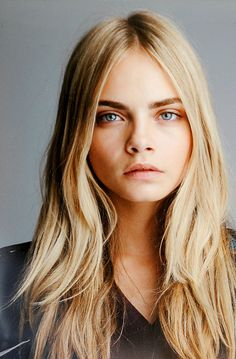 cara delevingne. Her blonde hair and dark brows are spectacular.