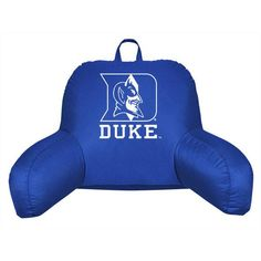 Get the back support needed for good posture while proudly displaying your team pride in a dorm room, bedroom or family room with the practical and spirited Blue Devils bed rest pillow!  The Duke Blue Devils support pillow boasts the team color and logo centered on the back rest.  A comfortable support system that provides great back support for viewing the big game, reading or doing homework in bed or on the floor.  A sturdy handle has been attached that allows easily moved from room to…