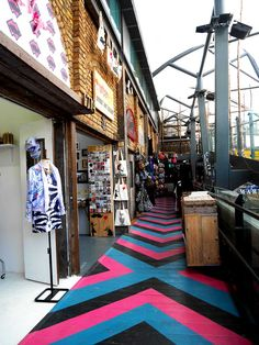 Camden Locke Market, also known as the Horse Stable Market with colourful chevron floor, London, UK