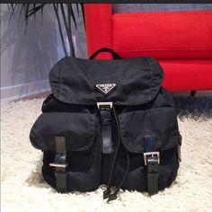 "Prada Small Black Nylon Vela Backpack Tophandleandadjustablebackstraps.Drawstringunderneathfrontflap;magneticandbuckleclosures.Twofrontflappockets;buckleclosures.Buckledetailonsides.121/2""HX113/4""Wx6""D.MadeinItaly. This bag has some wear on the straps as pictured. Prada Bags Backpacks"