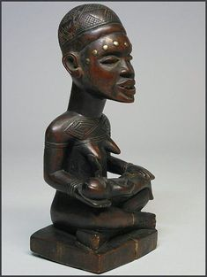 "Yombe maternity figure - Phemba 12"" tall - wood, metal tack - a very aesthetically pleasing example. This figure is most probably an example of a type of sculpture called pfemba (or phemba) that is related to a women's cult concerned with enhancing fertility and the treatment of infertility. The Kikongo word p..."