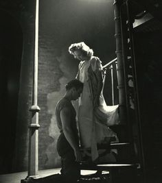 A Streetcar Named Desire, Marlon Brando kneeling before Kim Hunter. Photo by Eliot Elisofon, 1947.