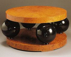 French Art Deco: Occasional table by Ernest Boiceau (suiss 1881 - 1950): ebonised wood and birds-eye maple.