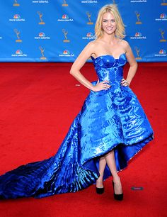 January Jones....    August 29, 2010    The blonde beauty wore a showstopping Atelier Versace gown and $1.2 million Cartier earrings at the Primetime Emmy Awards in L.A.