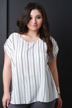 This plus size blouse top features a lightweight texture with vertical stripe fabrication and a round neckline. Finished with short sleeves with a button accent and a keyhole cutout in the back. Acces
