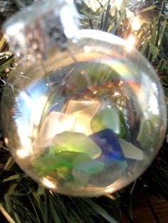 12 Homemade Xmas Ornaments to Make- I collect sea glass and could keep memories by making an ornament, tagging it with the location I found it!