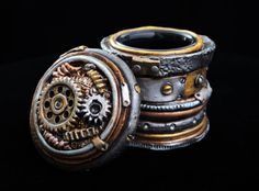 Steampunk Stash Jar topped with gears, this one of a kind clay covered stash jar is air tight, light tight, and cool!