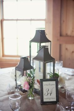 Simple lantern centerpieces offer a touch of rustic charm to your modern and elegant wedding