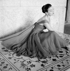 Norman Parkinson, 1956 - Anne Gunning wearing an evening dress in rose red chiffon