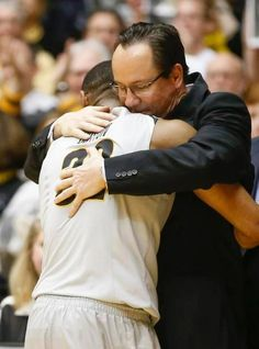 Gregg Marshall hugs senior guard Tekele Cotton at the end of the Shockers' 74-60 win over Northern Iowa during at Koch Arena on Saturday.