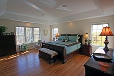 Bedroom with hard wood floors and ample natural light to fill it.