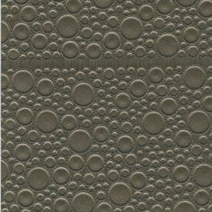LEATHER ROUNDELS-14 Leather Roundels is shagreen on a grand and stylized scale. Varying sized circles are stitched into leather and arranged into tiles. It is a fun and lighthearted take on what is otherwise known as a luxury item.
