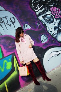 Fashion blogger Diana Arvizu of The Neon Factor styles a Forever 21 oversized hoodie, Zara red velvet blazer, and Christian Louboutin Paloma.  Graffiti mural location, Houston, TX