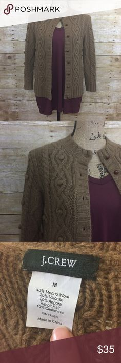 J. Crew Cashmere + Wool Cardigan J. Crew. tan/camel sweater cardigan. Oh so soft! Has wool and cashmere but isn't itchy at all, in fact it's one of the softest sweaters ever! Size medium. Dry clean only. Open to offers and 30% off bundles! J. Crew Sweaters Cardigans