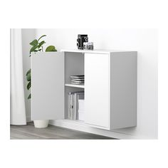 Yuo can have two of these on the wall above the ikea bookshelf that you already have.  27 1/2 square x 10 D.    EKET Cabinet with 2 doors and 2 shelves  - IKEA
