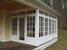 (CS: this on one side, screened porch for dogs in other end with open covered patio between) sunroom idea.open to the herb garden along with the hearth room. Küchen Design, House Design, Sunroom Windows, Transom Windows, Four Seasons Room, Sunroom Addition, Garage Addition, 4 Season Room, Enclosed Porches