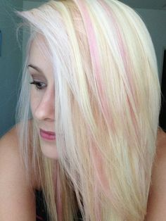 Light pink highlights on bleach blonde hair! ;) this is actually done with REVLON JUST BITTEN lip stain in the color PASSION! Stays on until your hair is washed :) just brush it through your hair to get the desired pinkness. I must warn you...don't press to hard unless you want bright pink :)