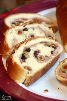 Pan de Jamon is a traditional Venezuelan Christmas bread filled with ham and olives. Its robust flavors are a unique tribute to Venezuelan culture. Christmas Bread, Christmas Dishes, Christmas Recipes, Christmas Cookies, Christmas Time, Pastry Recipes, Bread Recipes, Cooking Recipes, Gourmet Cooking