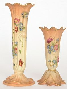 Two Royal Worcester blush ivory buds vases, the first Grangers shape 1015 and formed as a trumpet vase rising from a lily pad, the second Grangers shape 195 and decorated with spring flowers, all with puce marks and various datecode