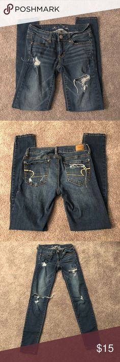 dark wash ripped jeans been worn many times but still in good condition! super comfortable American Eagle Outfitters Jeans Skinny