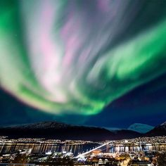 "Northern Lights. By Ole Salomonsen Photography (@arcticlightphoto) on Instagram: ""«Powerburst» - A magnificent multicolored aurora over the city of Tromso, Norway."""