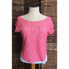 Lace sheer pink crop top sz M sh.sleeve & stretchy Lace sheer pink top sz medium sh sleeve & stretchy. Made in the USA Tops