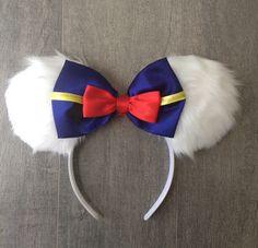 Donald Duck ears by SistersHead2Toe on Etsy https://www.etsy.com/listing/243292131/donald-duck-ears