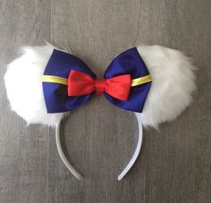 Donald Duck ears by SistersHead2Toe on Etsy https://www.etsy.com/listing/243292131/donald-duck-ears