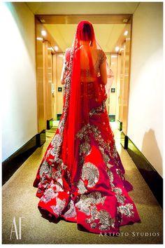 Manish Malhotra bridal lehenga , red bridal lehenga , red and gold bridal lehenga, red and silver lehenga , bridal lehenga with train