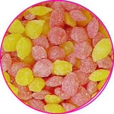 Sherbet Pips...I used to buy these at our little sweetie shop, they were put into a little triangular bag and twisted really tightly to close it...loved them, made the roof of my mouth sore!!...lol