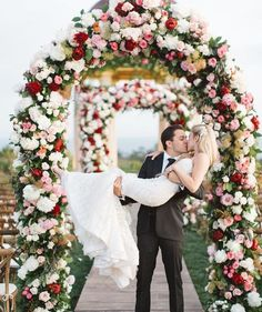 Photographer: Brandon Kidd Photography, Via Bloom Box; Romantic red and white flower green wedding ceremony chuppah;