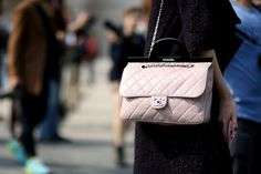 The Street Style Accessories That Stopped Traffic at Fashion Week ---  A baby-pink touch of Chanel.