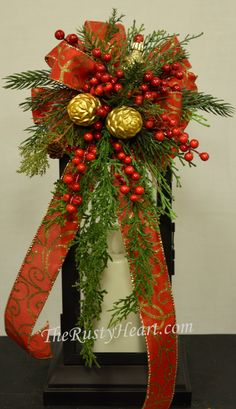Our lantern swags are great way dress up any lantern! This swag is decorated with Christmas ribbon, various greens, pinecones, and berries. They are versatile and can be used on a wreath, mirror, and so many other places! The swag measures approx. 7.5 W x 16L. They simply attach with wired chenille. Lantern is NOT included in sale. *Please note our handmade items may vary slightly.  ***Swag shown on Lantern measuring 17H x 6.5W x 6.5D ***  We have many sizes of lanterns, if the swag is not…