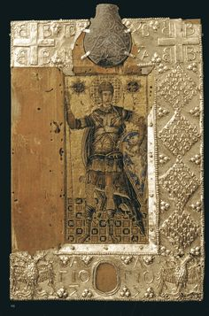 """""""Mosaic Icon of St. Demetrios with Reliquary Flask"""" ; Flask: Byzantine, 13th or 14th century; mosaic: 14th or 15 century; frame: mid-15th century; Wax, wood, paint, silver gilt, lead; 24.3 X 16 cm, mosaic: 12.5 X 5.5 cm, lead flask: height 5.2 cm; Sassoferrato; Museo Civico, Sassoferrato"""