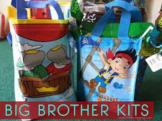 Big brother gift/kit... Snacks, games/toy, disposable camera?, hand sanitizer/soap, shirt?, book