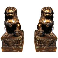 A Pair of Gilt Bronze Foo Lions | From a unique collection of antique and modern sculptures and carvings at http://www.1stdibs.com/furniture/asian-art-furniture/sculptures-carvings/