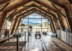 """Taking cues from traditional farmsteads, The Barn combines both rustic and modern details to complement the natural landscape. The wooden house was designed by Carney Logan Burke Architects, an architecture, interior design and product design studio. """"The power of landscape, the quality of light and the simple honesty of vernacular architecture"""" influence the practice's designs, …"""