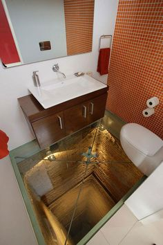 I would love a house with all the cool amenities listed in this article, with the exception of this bathroom floor above an abyss...that and the see-through bathtub...I hate doing windows...