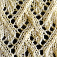 The Lattice Lace stitch is a lace stitch that resembles a lattice which has a interweaving sections separated by lace. This stitch is a 12-row repeat and has excellent drape.
