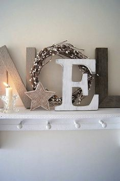 Wooden letters painted red with a small green wreath would also like nice. Decoupage different patterns of Christmas scrapbook paper or wrapping paper on wood letters is another idea. Farmhouse Christmas Decor, Rustic Christmas, Simple Christmas, Christmas Art, Christmas Themes, White Christmas, Christmas Decorations, Holiday Decor, French Christmas