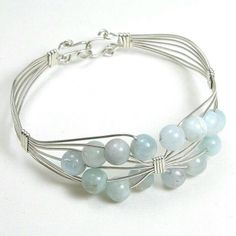 Handmade gemstone aquamarine and silver wire bracelet features semi-precious, round aquamarine gemstones, and hook clasp. Add a necklace, pendant and earrings to compliment this bracelet Handmade Wire Jewelry, Wire Wrapped Jewelry, Metal Jewelry, Beaded Jewelry, Jewellery, Bracelet Fil, Homemade Jewelry, Jewelry Patterns, Jewelry Crafts